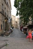 Tourists strolling in the central square of the french city of Pezenas, France. Tourists strolling in the central square of the french city of Pezenas, Herault stock image