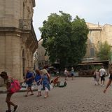 Tourists strolling in the central square of the french city of Pezenas,  France Stock Images