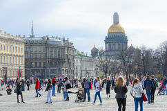 Tourists are strolling on Palace Square, St. Petersburg, Russia Royalty Free Stock Photo