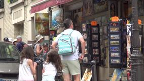 Tourists strolling on Paris Street Shopping Souvenirs and Visiting Small Stores stock video