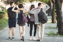 Tourists or students with backpacks walking. Friendship, togetherness, traveling, vacation, holidays, sightseeing, city tour, student exchange program. Tourists Royalty Free Stock Photo