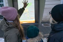 Tourists study the map of Lviv in the winter royalty free stock images