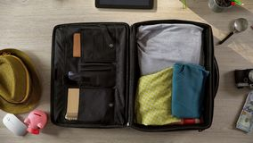 Tourists suitcase packed carefully for travel, going on trip, summer vacations