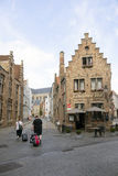 Tourists with suitcases in centre of medieval bruges in belgium Royalty Free Stock Photo