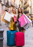 Tourists with suitcases and shopping bags. Positive tourists with suitcases and shopping bags outdoors Stock Photos