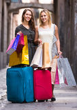Tourists with suitcases and shopping bags Stock Images