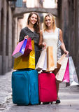 Tourists with suitcases and shopping bags Royalty Free Stock Images