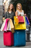 Tourists with suitcases and shopping bags Royalty Free Stock Photos
