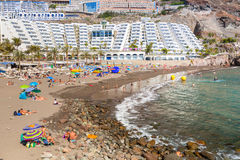 Tourists on sun holidays at the Taurito beach, Gran Canaria Royalty Free Stock Photos