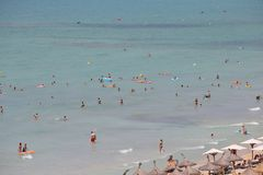 General view over Tourists sunbathing or bathing on the sea in El Arenal beach in Mallorca Stock Images