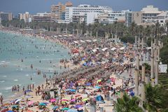 Tourist sunbathe or bath on the sea in crowded El Arenal beach in Mallorca Stock Photography
