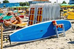 Tourists sunbathe on  beach in Bellaria Igea Marina, Rimini Royalty Free Stock Images