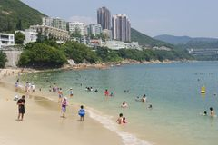 Tourists sunbathe at the Stanley town beach in Hong Kong, China. Stock Photography