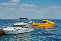 Tourists sunbathe, swim and relax on beach having fun Royalty Free Stock Image