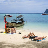Tourists sunbathing in phi phi island Royalty Free Stock Photos