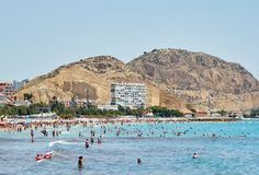 Tourists sunbathing on a Postiguet Beach of Alicante city. Spain Stock Photo