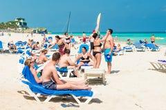 Tourists sunbathing at Varadero beach in Cuba Stock Photography