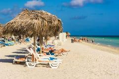 Tourists sunbathing at Varadero beach in Cuba Stock Photos