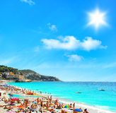 Tourists, sunbeds and umbrellas on hot day. Travel background Stock Images