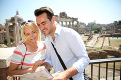 Tourists on sunny day discovering Roma Forum Stock Images
