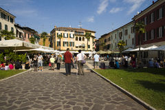 Tourists sunny day Sirmione, Italy Royalty Free Stock Images
