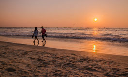 Tourists at sunset at kolava beach goa Stock Images