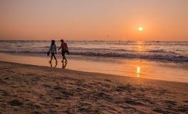 Tourists at sunset at kolava beach goa Stock Images