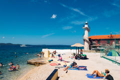 Tourists swim in the Adriatic sea near Zadar on sunny day Stock Images