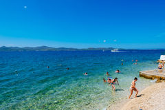 Tourists swim in the Adriatic sea near Zadar on sunny day Royalty Free Stock Image