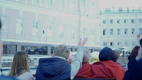 Tourists swim along the canals on the boat, waving their hands to passers-by. slow motion. 1920x1080. full hd stock video