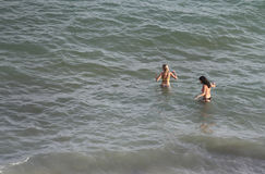 Tourists swim in the Magaluf beach in Majorca Royalty Free Stock Image