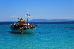 Tourists swimming in the blue of the Aegean Sea Stock Photography