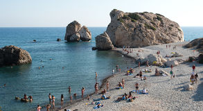 Tourists swimming and relaxing at famous Rock of Aphrodite beach Royalty Free Stock Image
