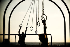 Tourists swinging on rings Royalty Free Stock Images