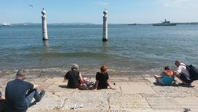Tourists by Tagus river Stock Photo
