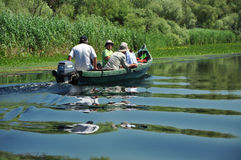 Tourists take boat trip in the Danube Delta Biosphere Reserve Royalty Free Stock Image