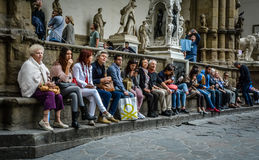 Tourists take a break - Florence, Italy. There are so many attractions to see in Florence and sometimes you need a small break, where you sit down and take a Stock Image