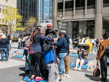 Tourists take group selfie at NFL display on Michigan Avenue, Ch Royalty Free Stock Image