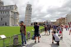 Tourists take a photo of Themselves before the leaning tower of Pisa Stock Photography