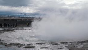 Tourists take photos of geyser.  stock footage