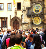 Tourists take pictures of antique Prague tower clock Royalty Free Stock Image