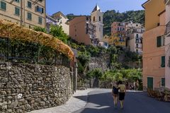 Tourists take pictures in the historic center of Manarola, Cinque Terre, Liguria, Italy. Europe royalty free stock photos