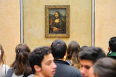 Tourists take pictures the Mona Lisa (Monna Lisa or La Gioconda in Italian and La Joconde in French) painting at the Louvre Museum Stock Photos