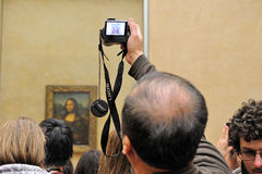Tourists take pictures the Mona Lisa Stock Image