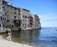 Tourists take pictures of old buildings. Tourists take take pictures of old buildings in the old town of Rovinj, located on the Adriatic coast.Croatia royalty free stock photo
