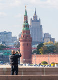 Tourists take pictures on your phone tower of Moscow Kremlin, Ru stock photos