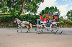 Tourists take a ride during a weekend at Museum Sungai Lembing, Kuantan, Pahang, Malaysia. PAHANG, MALAYSIA - SEPT 1: Tourists take a ride during a weekend at royalty free stock photography