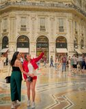 Tourists take selfies in the central Galleria Vittorio Emanuele in the city of Milan
