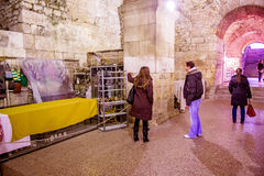 Tourists take a tour of the historic cellars of the Roman Emperor Diocletian in Split, Croatia Stock Image