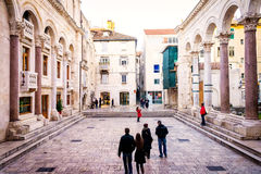 Tourists take a tour of the remains of palace of the Roman emperor Diocletian in Split, Croatia Royalty Free Stock Photo